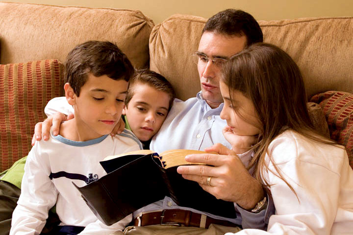 Picture of a family reading scriptures together